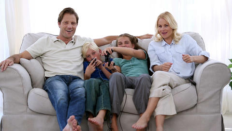 Happy family playing video games at home Footage
