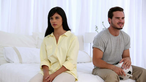 Woman getting annoyted while her boyfriend watchin Footage