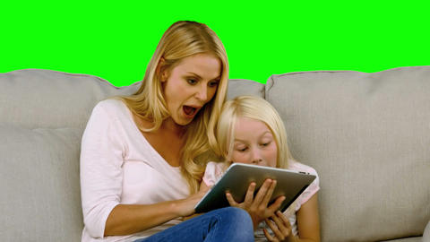 Mother and her daughter using digital tablet in sl Footage