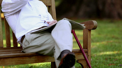 Retired Man Relaxing On A Bench stock footage