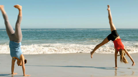 Attractive women doing cartwheels in front of the  Footage