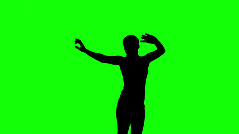 Silhouette of woman jumping and raising arms on green screen Live Action