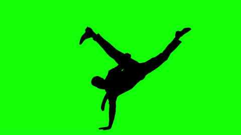 Silhouette of man with a tie breakdancing on green screen Live Action