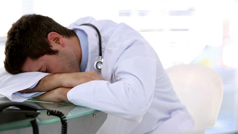 Sleeping doctor woken by his coworker Footage