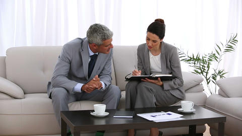 Businessman arranging an appointment with a collea Footage
