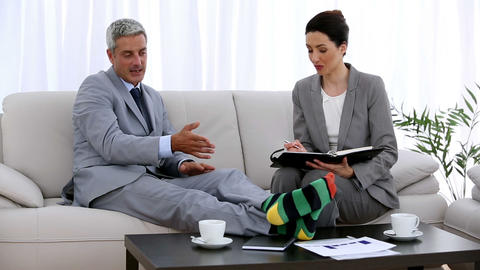 Businessman in socks making an appointment with a colleague Footage