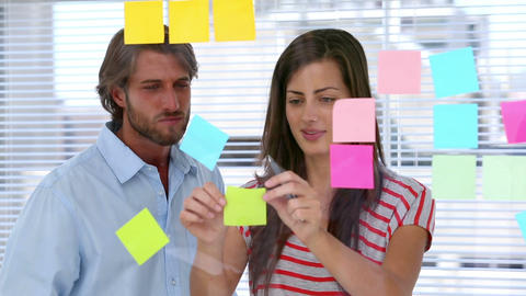 Creative team pointing adhesive notes Footage