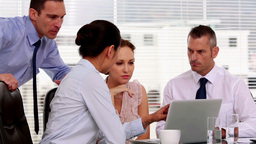 Businesswoman showing her colleagues something on  Footage