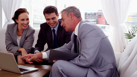 Business people pointing at a laptop Footage