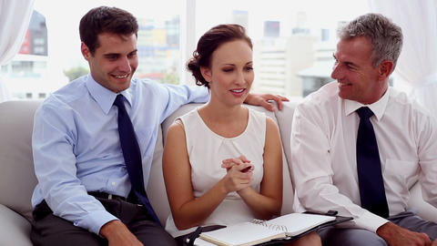Attractive businesswoman discussing with colleagues Footage