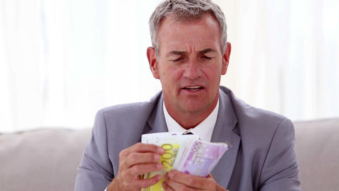 Happy businessman counting banknotes Footage