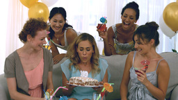 Woman blowing out birthday candles Footage