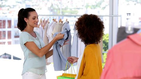 Woman admiring clothes bought by a friend Footage