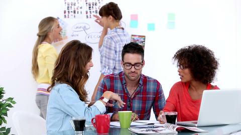 Team of designers brainstorming in their office Footage