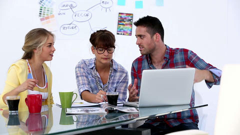 Attractive Designers Working Together stock footage