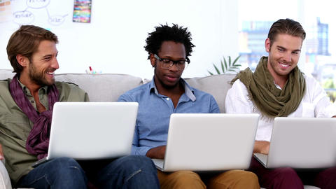 Three colleagues using laptop Footage