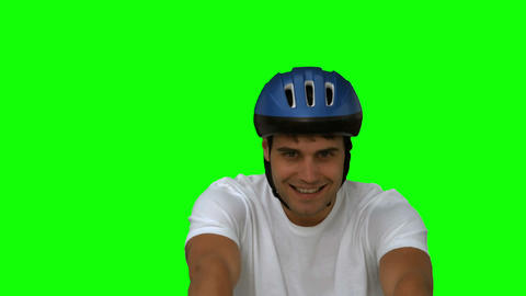 Man on his bicycle on green screen Footage