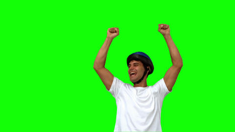 Man on his bicycle raising arms on green screen Footage