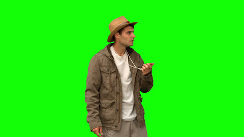 Lost man using a compass on green screen Footage