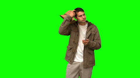 Lost man using his compass on green screen Footage