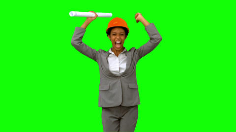 Architect raising arms on green screen Live Action
