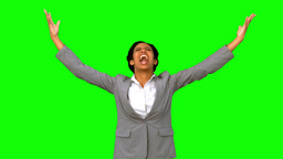 Angry businesswoman raising arms on green screen Live Action