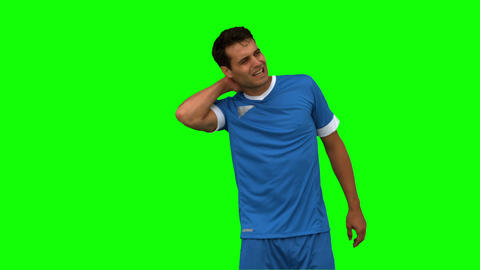 Football player suffering from neck pain on green screen Live Action