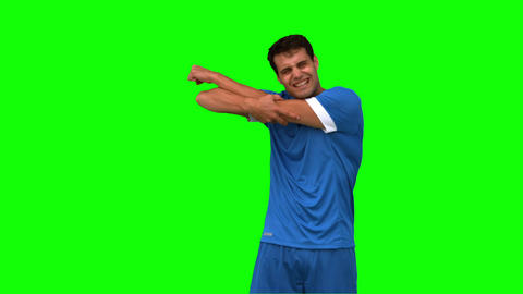 Football player suffering from arm injury on green screen Live Action