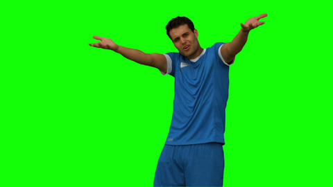 Furious football player gesturing on green screen Live Action