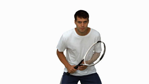 Handsome man training while playing tennis on white screen Footage