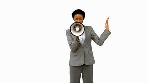 Businesswoman yelling into a megaphone on white screen Footage