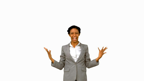 Pretty businesswoman raising arms on white screen Live Action