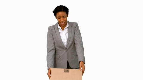 Fired businesswoman dropping a box on white screen Footage