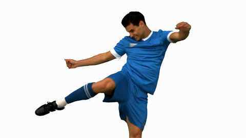 Football Player Kicking A Football On White Screen stock footage