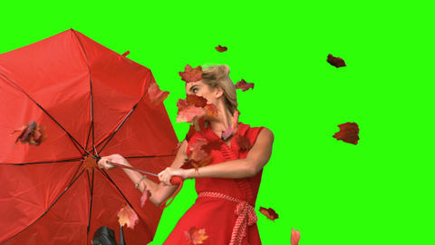 Pretty glamour woman holding a broken umbrella on green screen Live Action