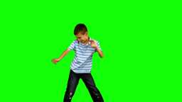 Little boy dancing on green screen Footage