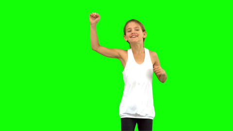 Little girl dancing on green screen Footage