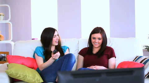Friends watching television together Footage