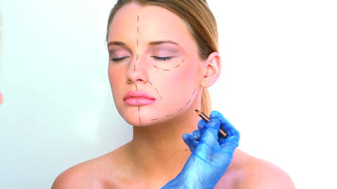 Gorgeous blond woman preparing for surgery Live Action
