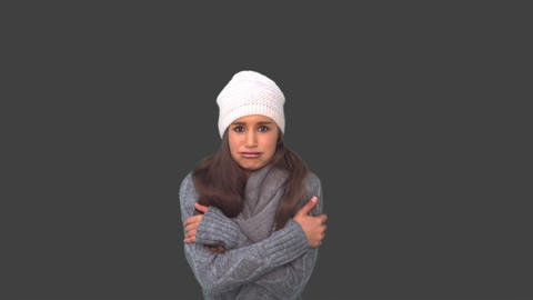 Cold cute young woman shivering Footage