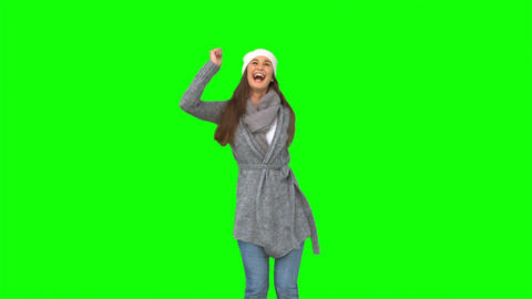 Happy young model in winter clothes dancing Footage