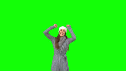 Happy young model in winter clothes jumping Footage