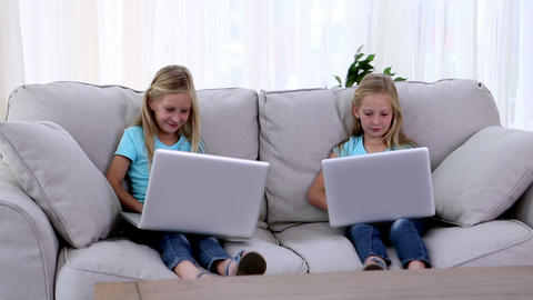 Sisters using laptops Footage