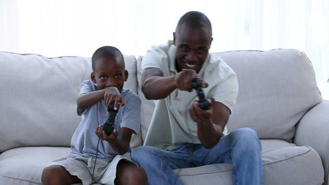 Father and his son playing video games Footage