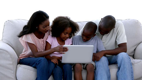 Family with laptop on a sofa Footage