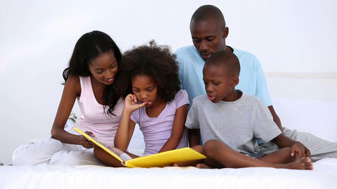 Son reading story to his family Footage