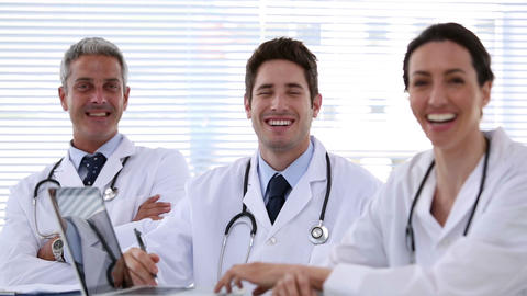 Team of doctors laughing together Footage