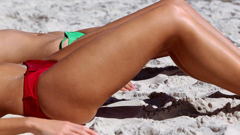 Attractive young women sunbathing on the beach Footage