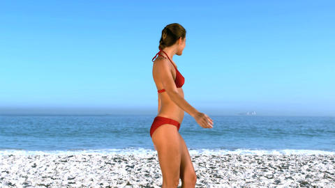 Woman posing and revolving on the beach Footage