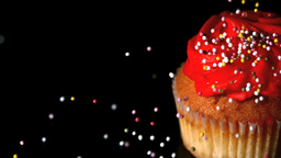 Sprinkles falling onto a cupcake Footage